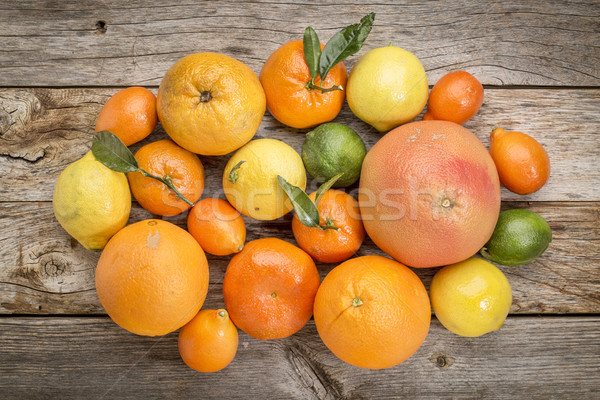 citrus fruit collection on weathered wood Stock photo © PixelsAway