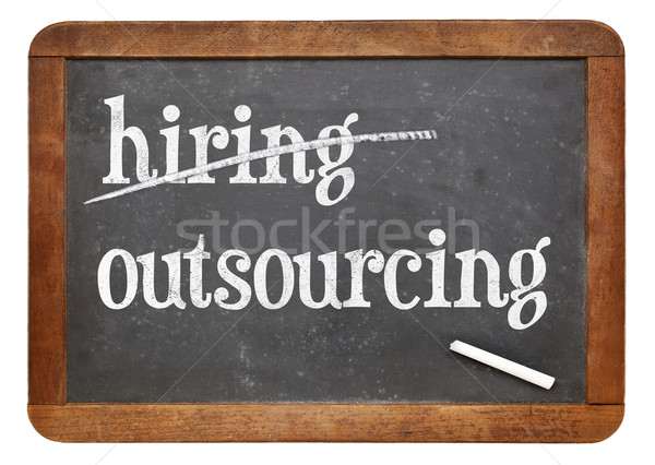 outsourcing instead of hiring concept on blackboard Stock photo © PixelsAway