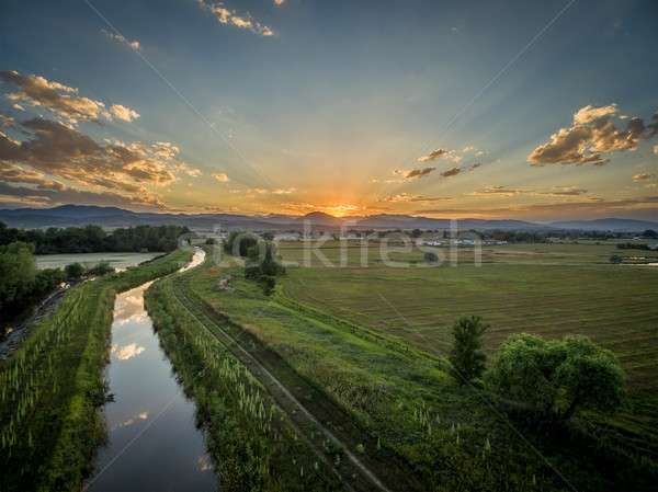 sunset over Rocky Mountains and foothills Stock photo © PixelsAway