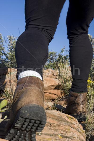 hiker legs on a mountain trail Stock photo © PixelsAway