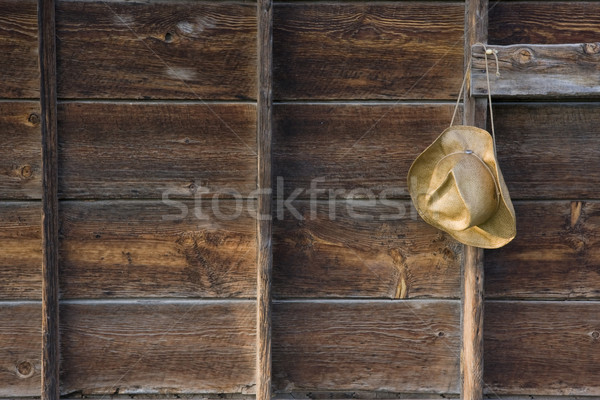 straw cowboy hat and weathered wood Stock photo © PixelsAway