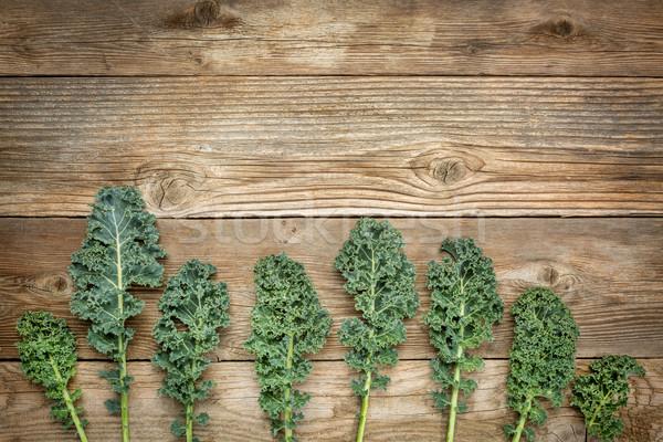 green kale leaves on wood Stock photo © PixelsAway