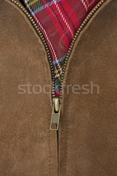 unzipped brass zipper of leather jacket Stock photo © PixelsAway
