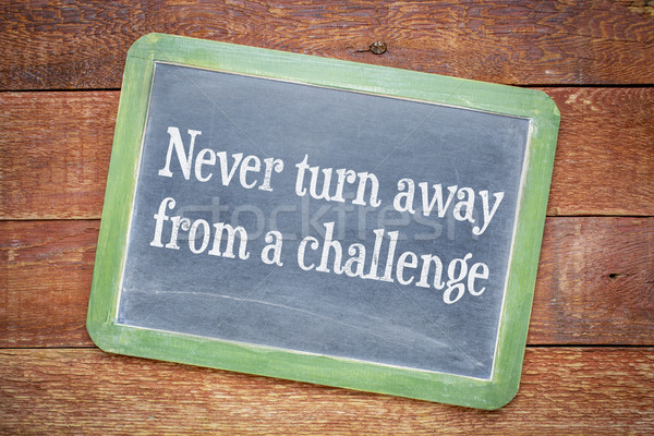 Never turn away from a challenge blackboard sign Stock photo © PixelsAway
