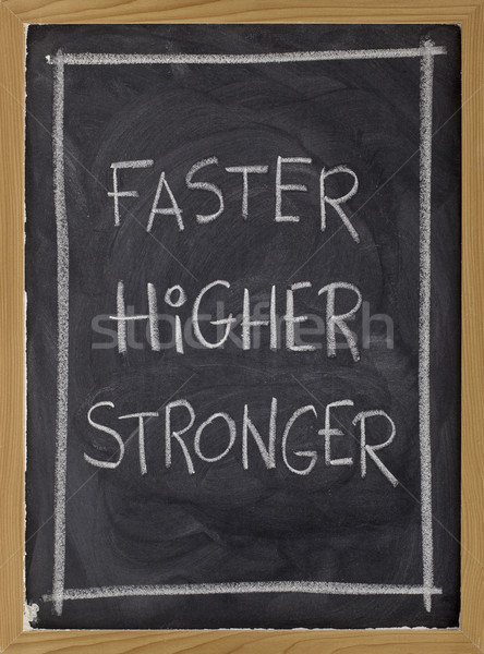faster, higher, stronger on blackboard Stock photo © PixelsAway