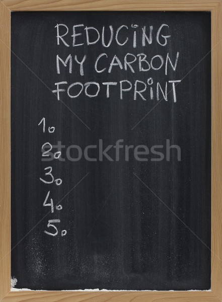 reducing carbon footprint on blackboard Stock photo © PixelsAway