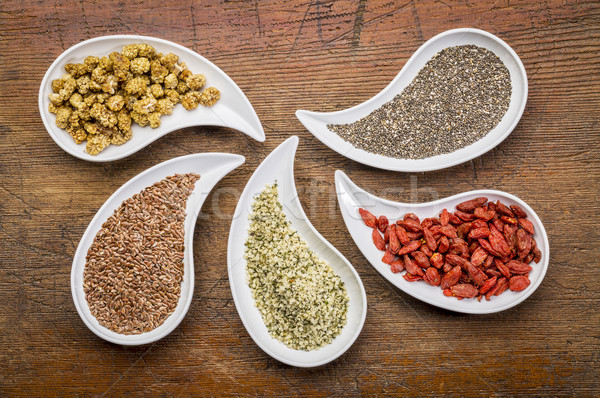 superfood collection in teardrop bowls Stock photo © PixelsAway