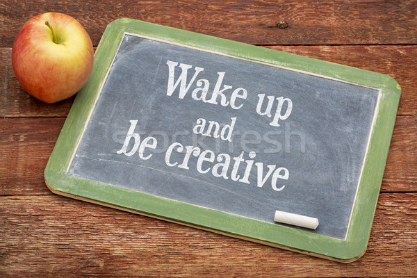 Wake up and be creative on blackboard Stock photo © PixelsAway