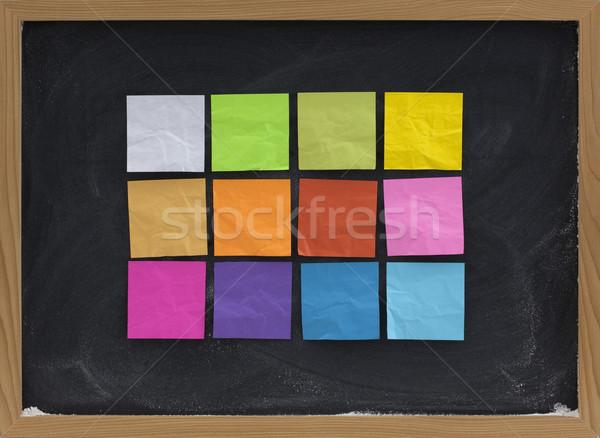 colorful sticky notes on blackboard Stock photo © PixelsAway