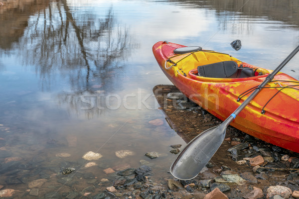 kayak with paddle on lake shore Stock photo © PixelsAway