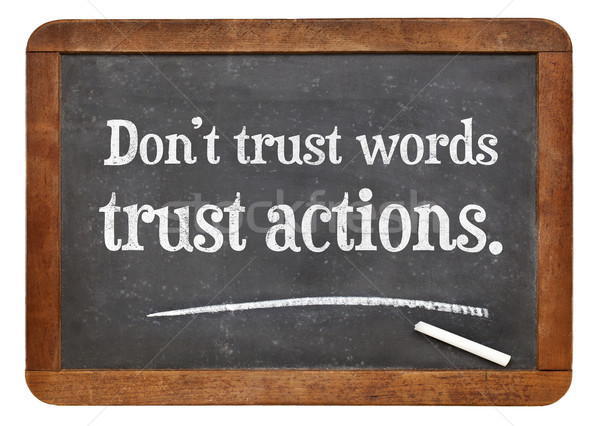Trust actions, not words blackboard sign Stock photo © PixelsAway