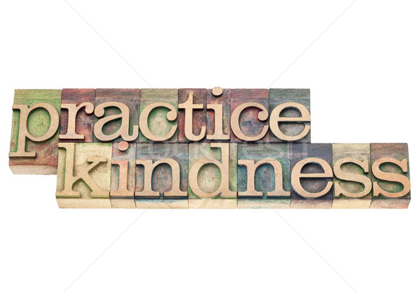 practice kindness in wood type Stock photo © PixelsAway