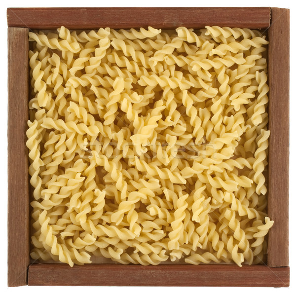 uncooked fusilli pasta in wooden box Stock photo © PixelsAway