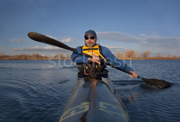 mature paddler in a narrow racing kayak Stock photo © PixelsAway
