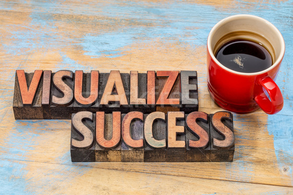 visualize success in wood type Stock photo © PixelsAway
