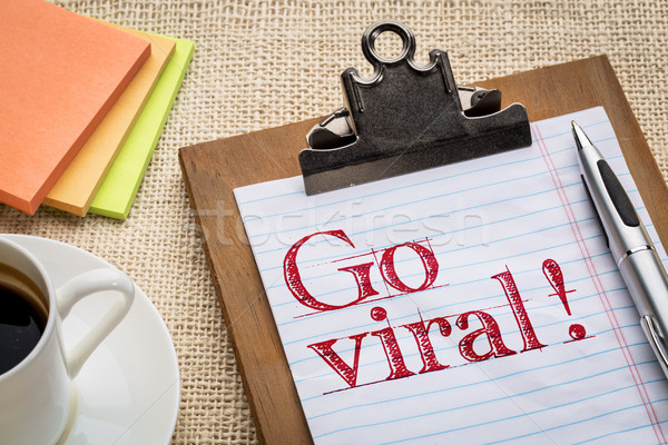 Go viral on clipboard with coffee Stock photo © PixelsAway