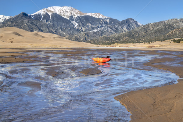 whitewater kayak in shallow water and sand dunes Stock photo © PixelsAway