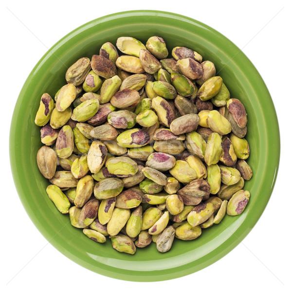 Bol pistache noix faible brut isolé Photo stock © PixelsAway