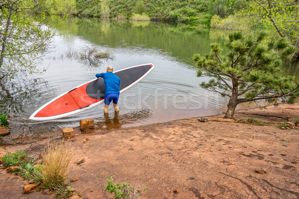 senior paddler launching  SUP paddleboard Stock photo © PixelsAway