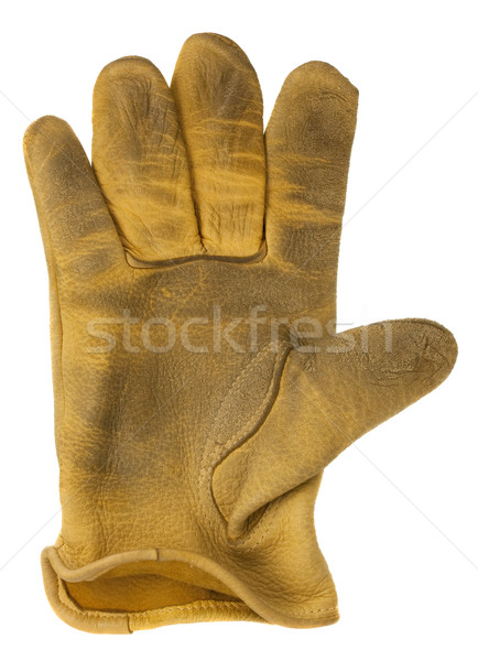 worn out yellow leather glove Stock photo © PixelsAway