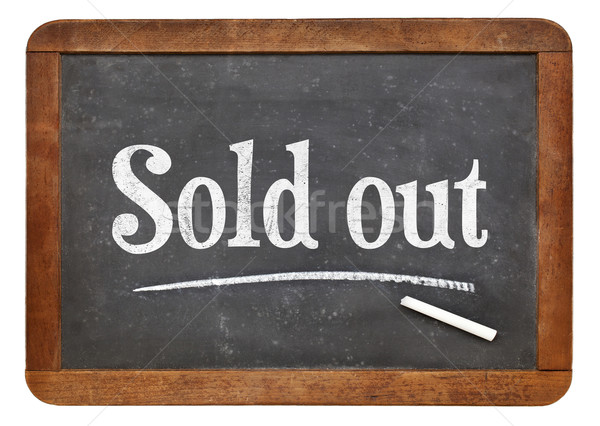Sold out blackboard sign Stock photo © PixelsAway