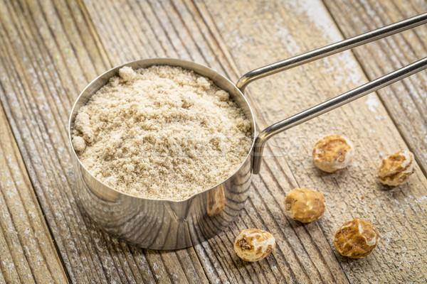 scoop of organic tiger nut powder Stock photo © PixelsAway