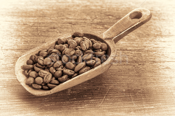 scoop of coffee beans in retro toning Stock photo © PixelsAway