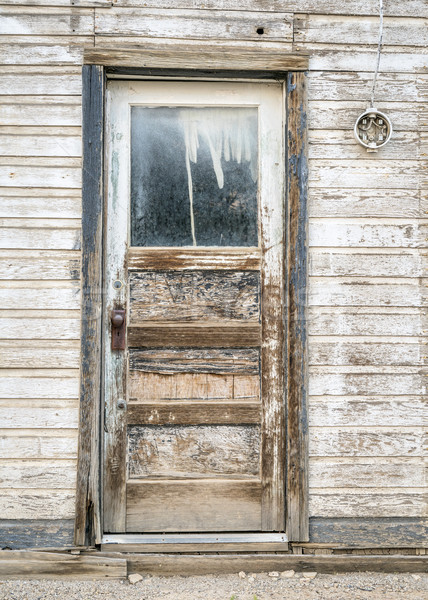 door to ghost town house Stock photo © PixelsAway