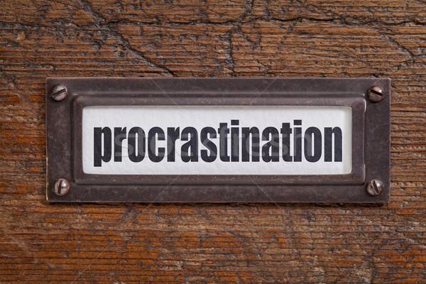 Procrastinação etiqueta palavra arquivo bronze Foto stock © PixelsAway