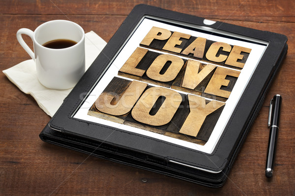 peace, love and joy on a tablet Stock photo © PixelsAway