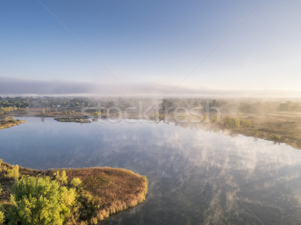 aerial view of a foggy lake Stock photo © PixelsAway