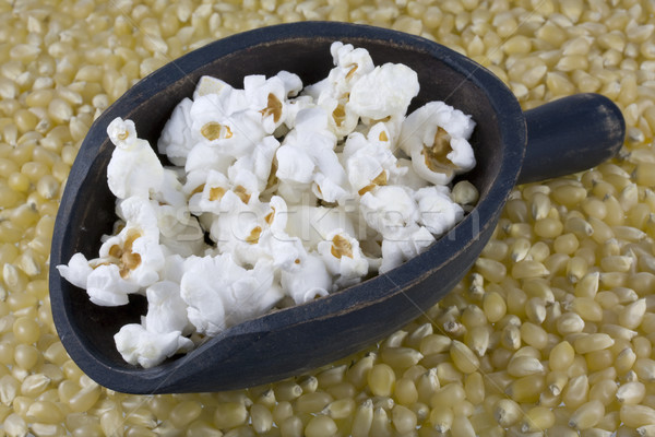 wooden scoop of popcorn and corn kernels Stock photo © PixelsAway