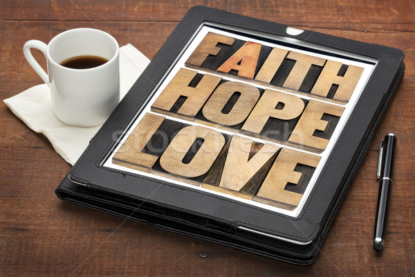faith, hope and love on digital tablet Stock photo © PixelsAway