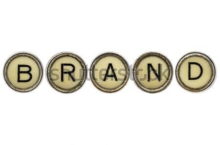 S'identifier mot machine à écrire touches vieux isolé Photo stock © PixelsAway