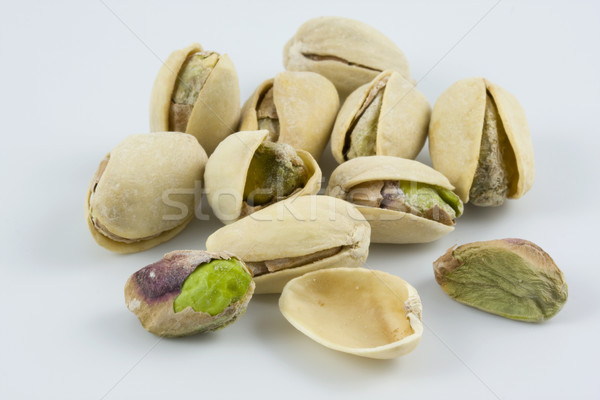 dozen of salted and roasted pistachio nuts Stock photo © PixelsAway
