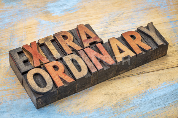 extraordinary word in wood type Stock photo © PixelsAway