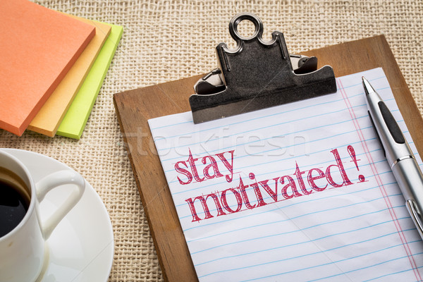 Stay motivated text ton clipboard Stock photo © PixelsAway