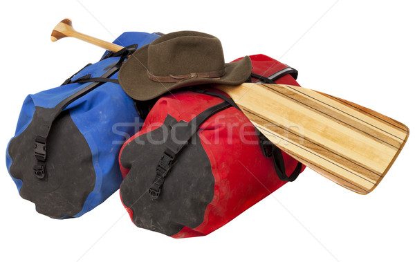 paddle, hat and waterproof luggage Stock photo © PixelsAway