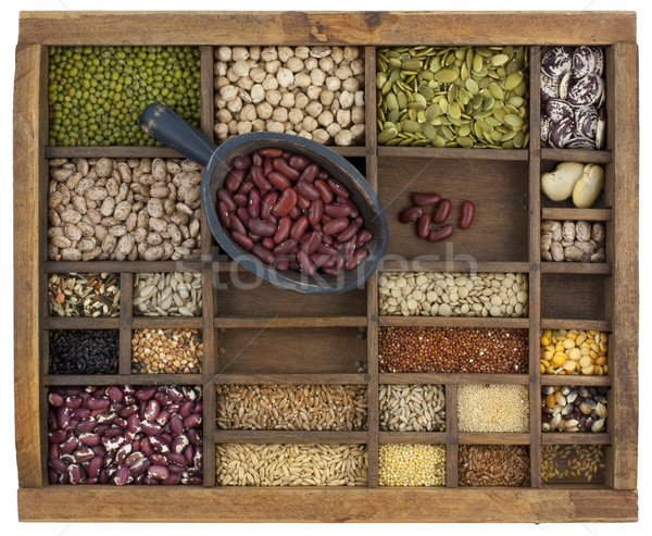 scoop of red kidney beans and a variety of grain and seeds Stock photo © PixelsAway