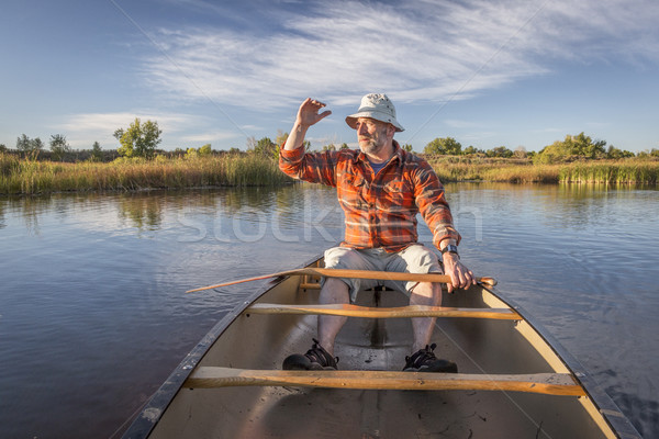 enjoying evening canoe paddling Stock photo © PixelsAway