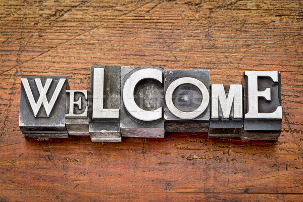 Stock photo: welcome word in metal type