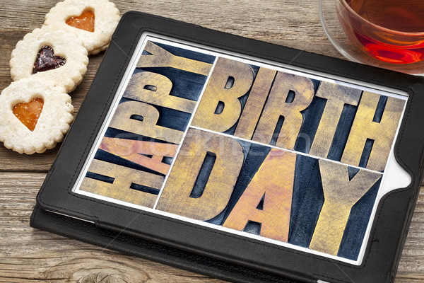 happy birthday on tablet with tea and cookies Stock photo © PixelsAway