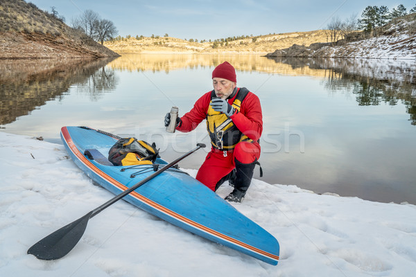 Hot tea break during winter paddling Stock photo © PixelsAway