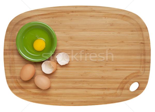 eggs on bamboo board Stock photo © PixelsAway
