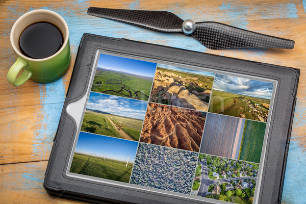 Reviewing aerial pictures on tablet Stock photo © PixelsAway