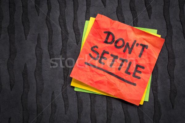 Do not settle reminder on sticky note Stock photo © PixelsAway