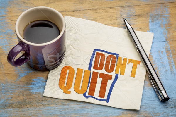 Stock photo: Do not quit word abstract on napkin