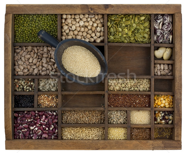 scoop of amaranth grain with old case in background Stock photo © PixelsAway
