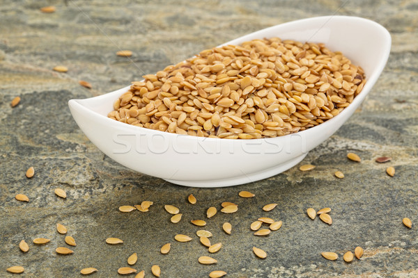 bowl of gold flax seeds Stock photo © PixelsAway