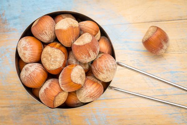 hazelnuts in metal measuring cup Stock photo © PixelsAway